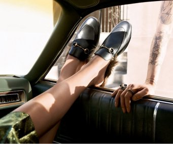 holding-gucci-loafers-fall-2015