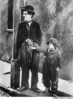 "ca. 1921 --- Charlie Chaplin and Jackie Coogan in ""The Kid"" BPA2# 3197 --- Image by © Bettmann/CORBIS"